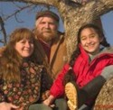 Nancy, Michael and Gracie Phillips: family tree on the family farm. (photo: Frank Siteman)